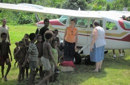missionaries and children by airplane