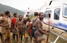 Tribal men check out a plane