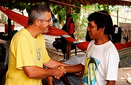 missionary shakes hands with tribal man