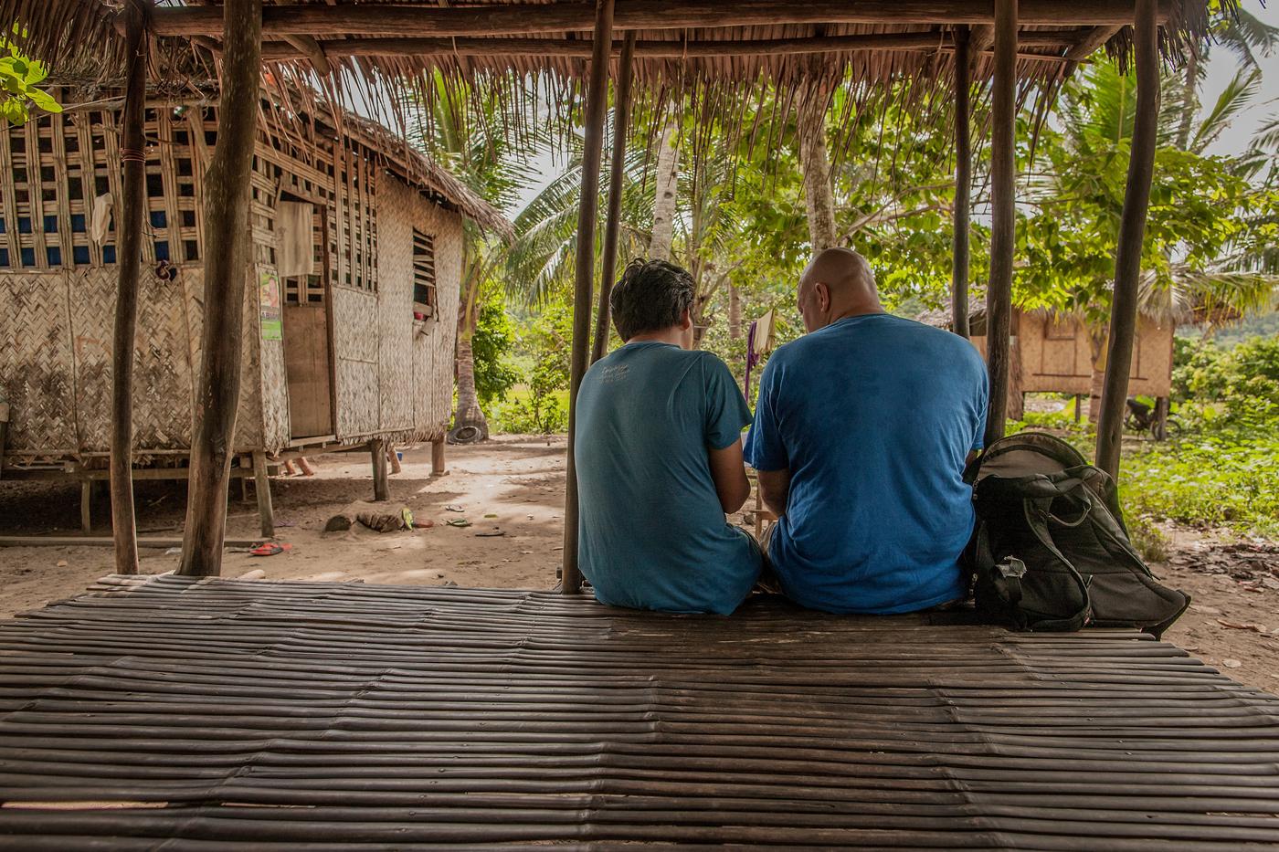 missionary and Filipino friend talking