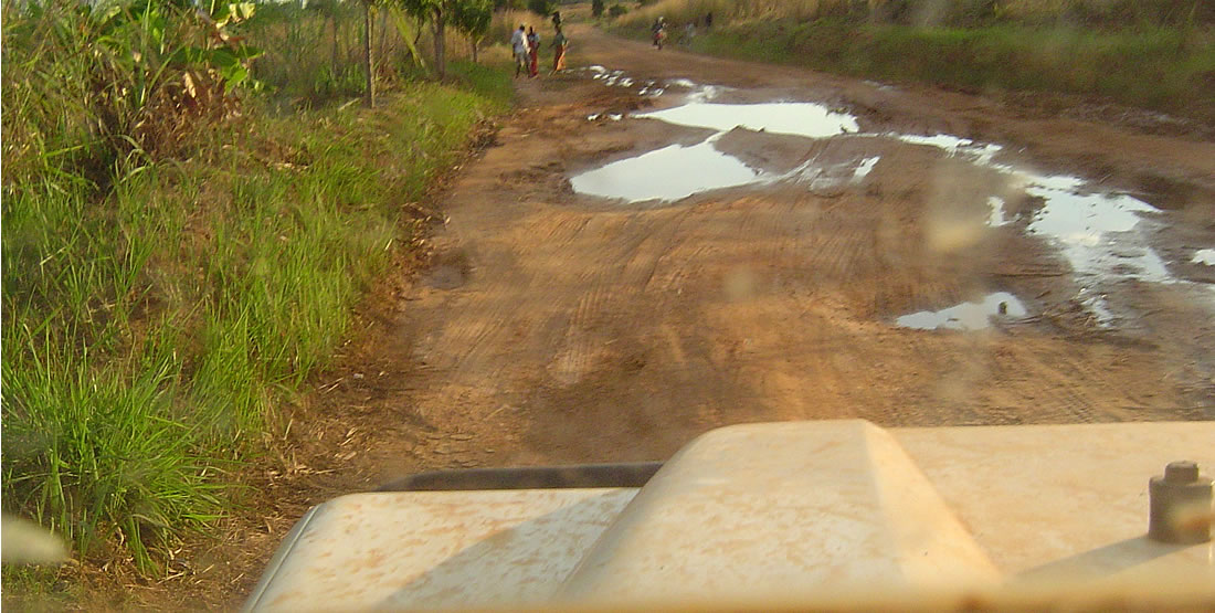 rutted road with water and mud
