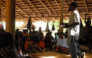 Nduan, one of the Inapang leaders, teaching.