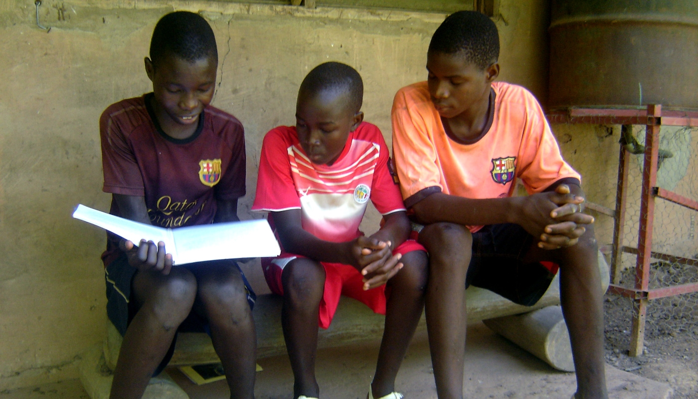 Budik boys study one of the books of the Bible.