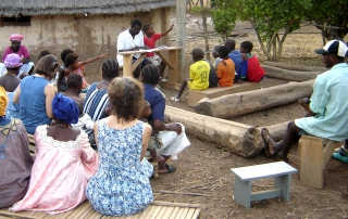 Budik teacher Pityan shares a Bible lesson with Budik believers.