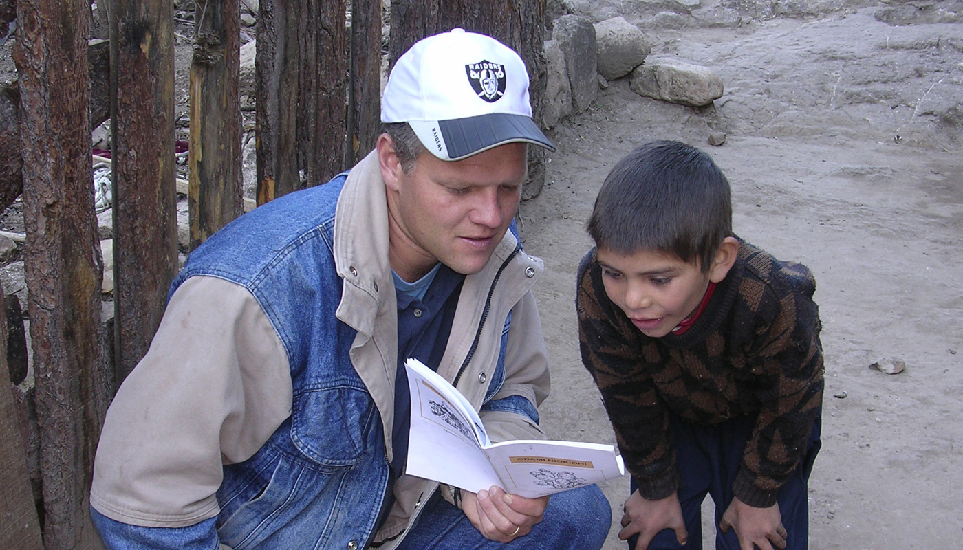 Young boy examines bible