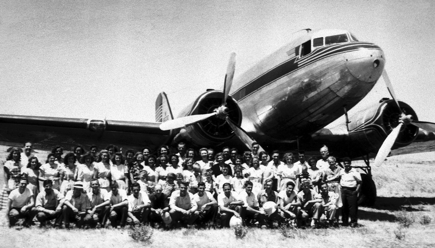 old plane with group of men