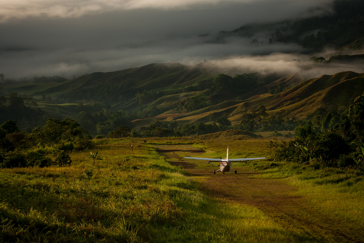 small plane on a mountainous runway