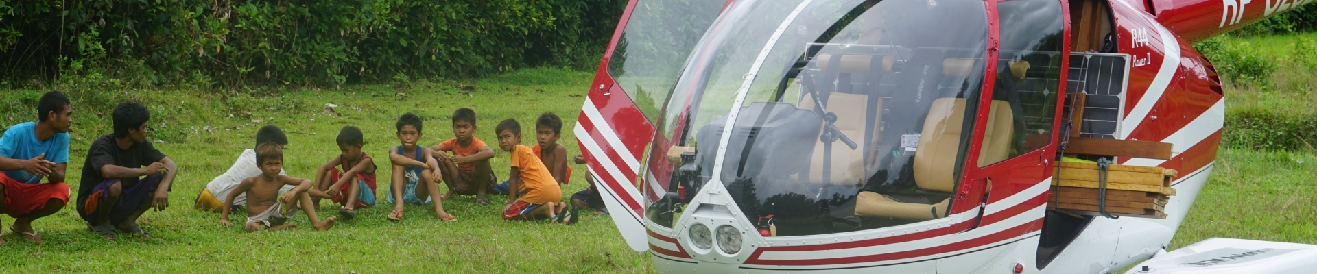 helicopter and tribal boys