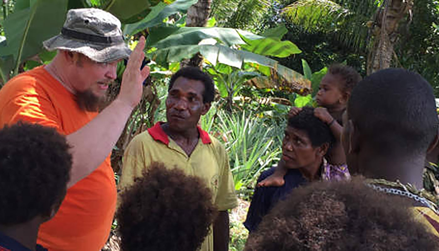missionary with people from Papua New Guinea