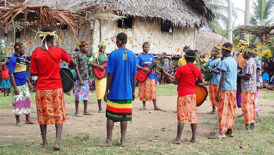 Iske people singing and playing instruments