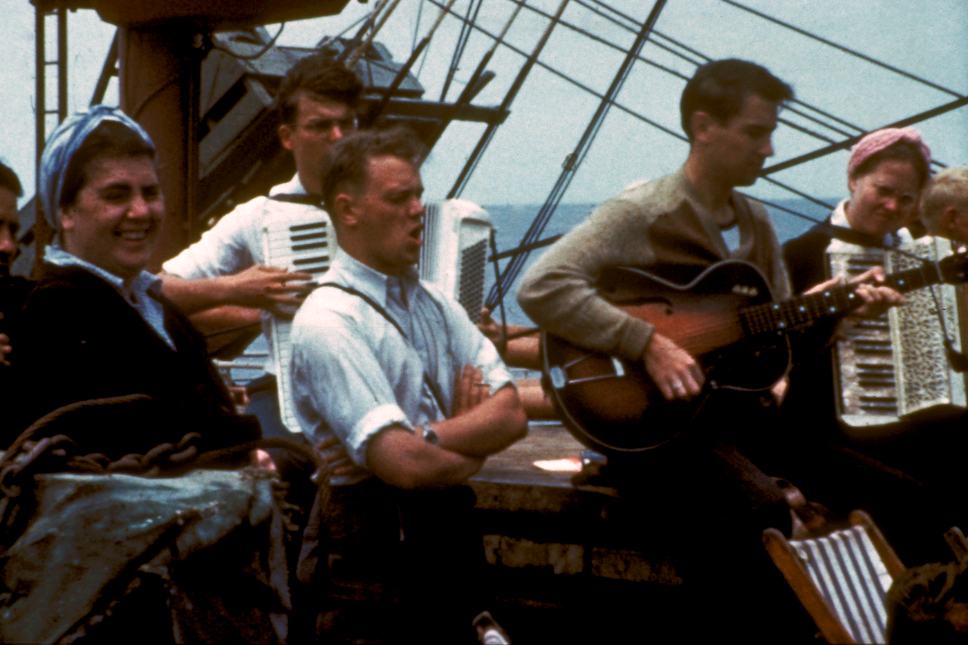 Missionaries singing on a boat