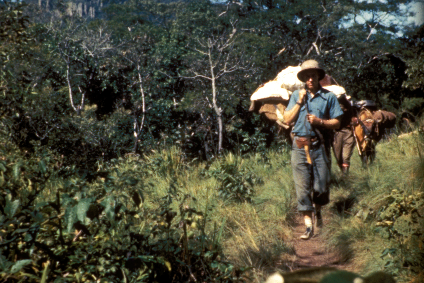 Missionary hiking into tribe