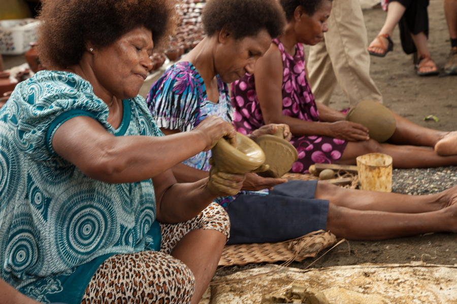 PNG women molding clay