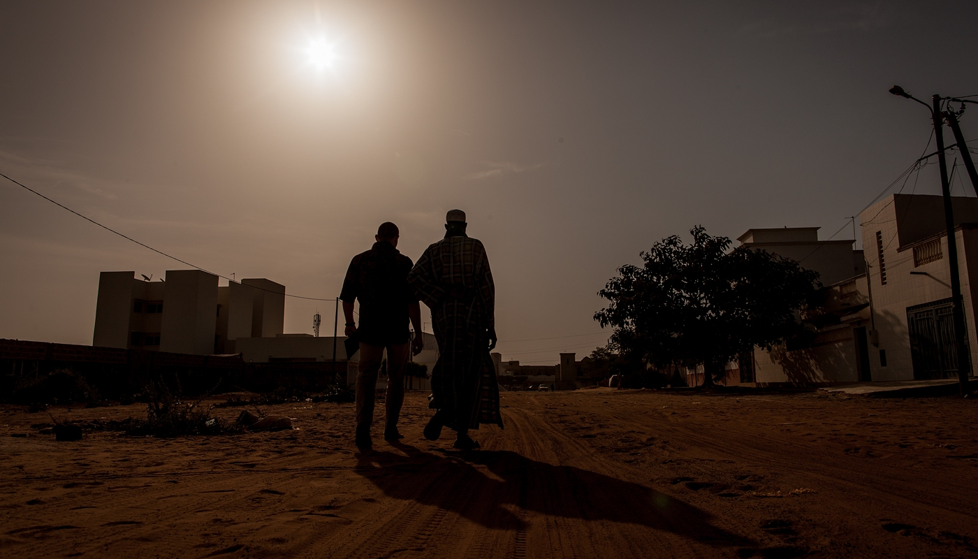 Silhouette of two men in Africa