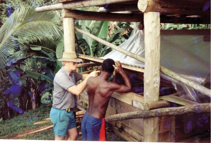 missionary standing with man from Papua New Guinea