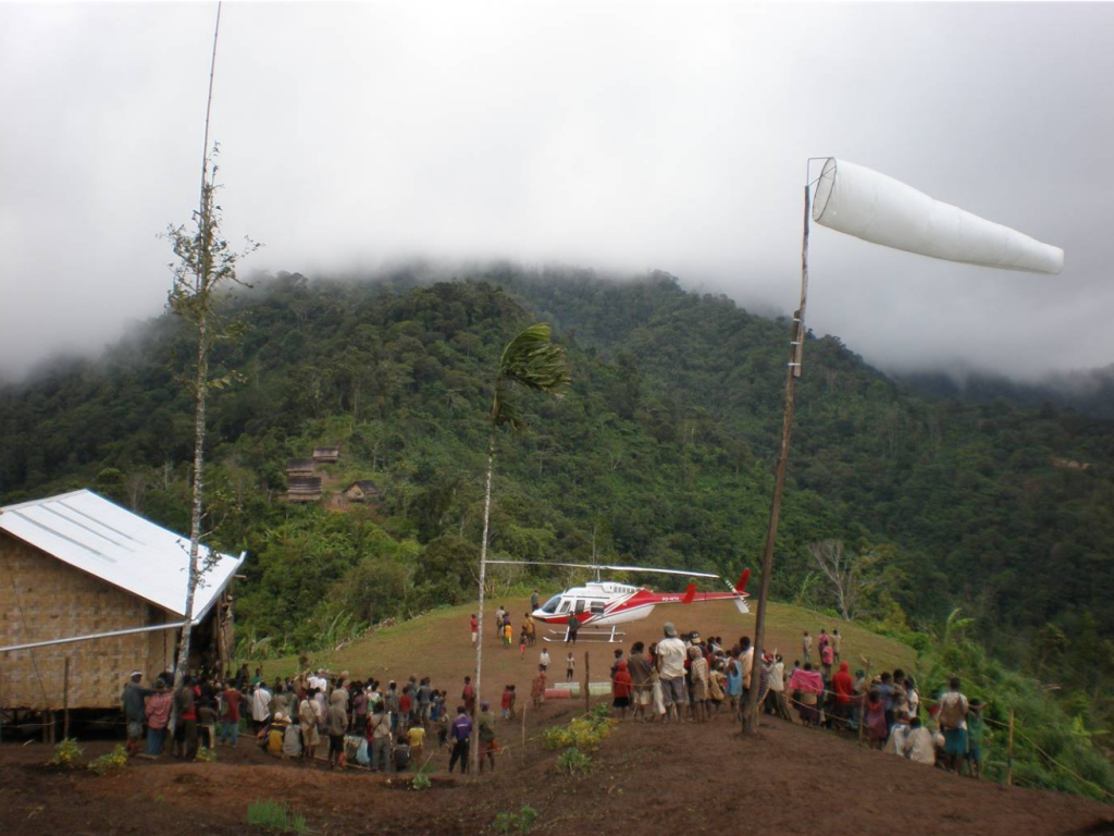 many villagers gather to meet helicopter that's landed
