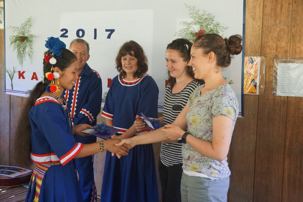 one of the first tala-andig graduates receives her diploma