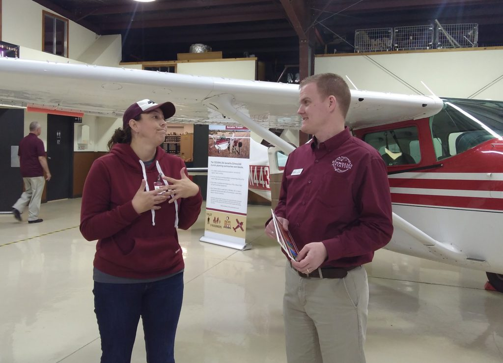 two people infront of a plane discuss training requirements to be a missionary aviator