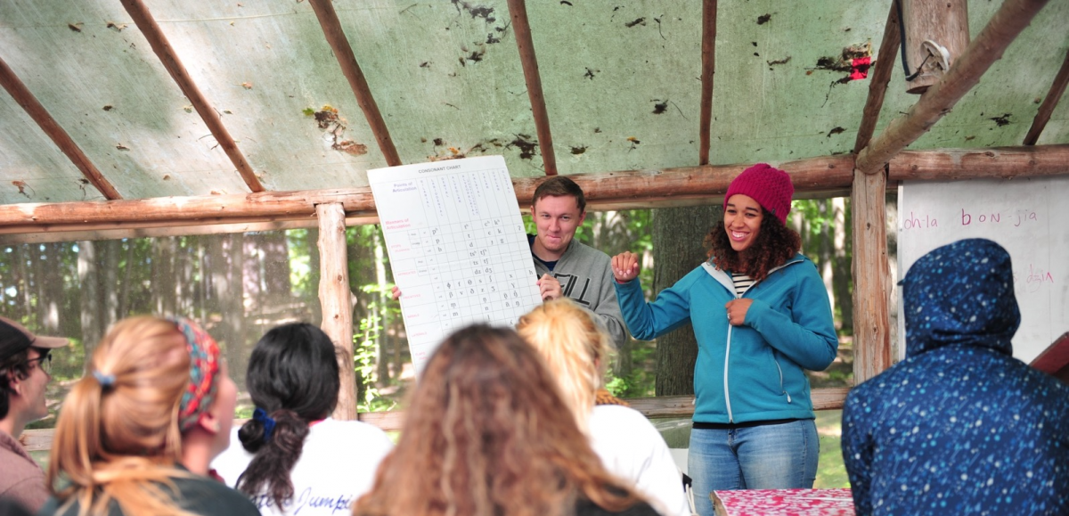 man and woman teaching students at Off the Grid