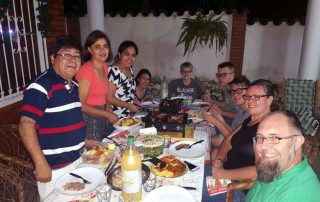 missionaries having a big meal with Paraguayan friends