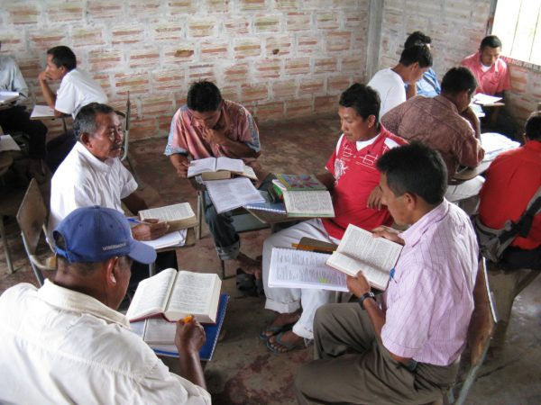 Colombian men studying the Bible