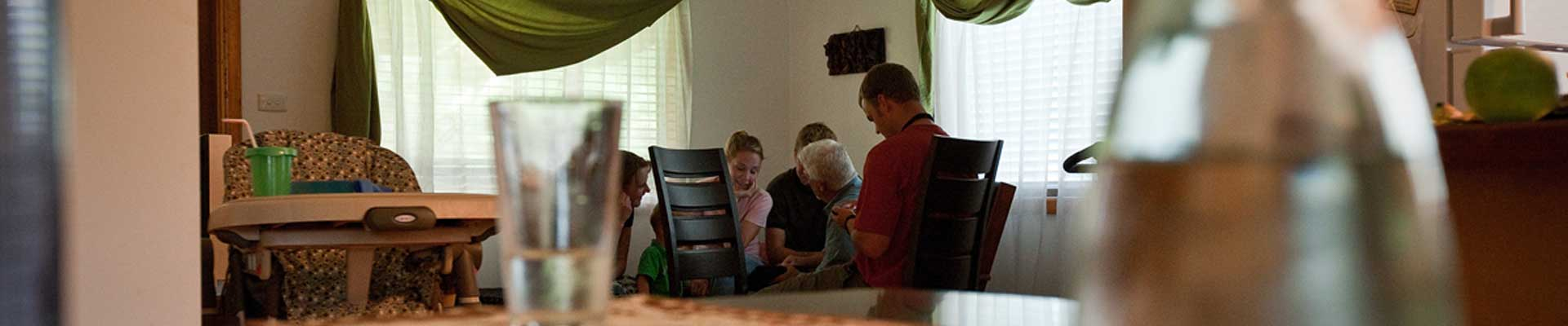 missionaries meeting in a house