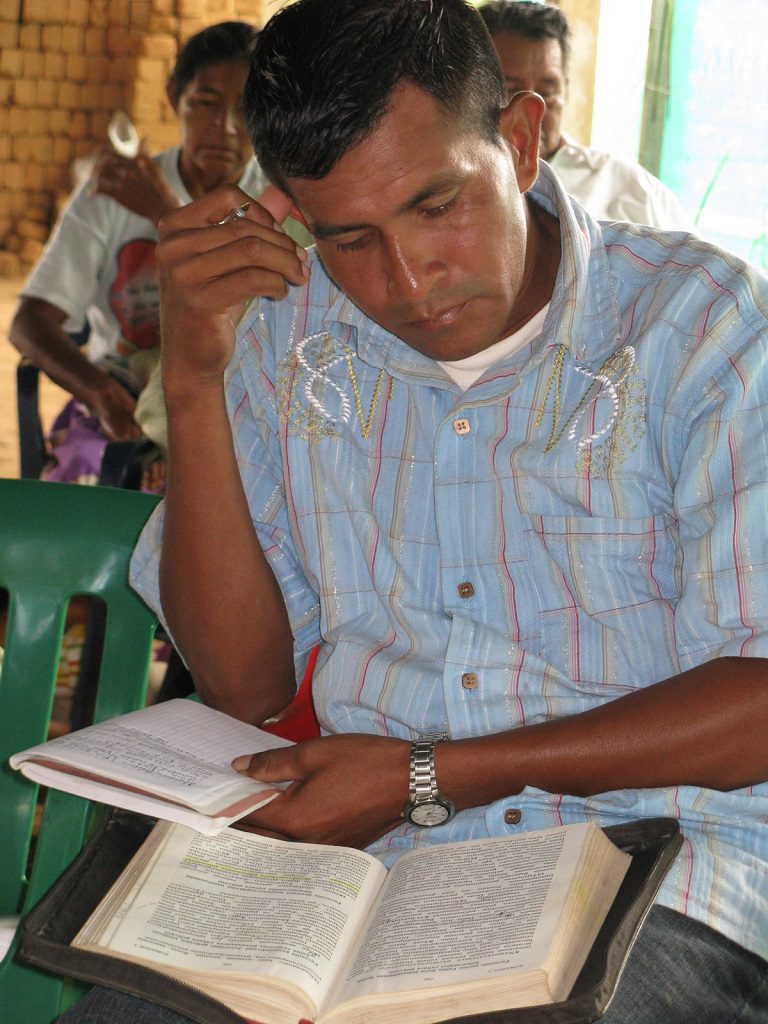 Guahibo man studying the Bible