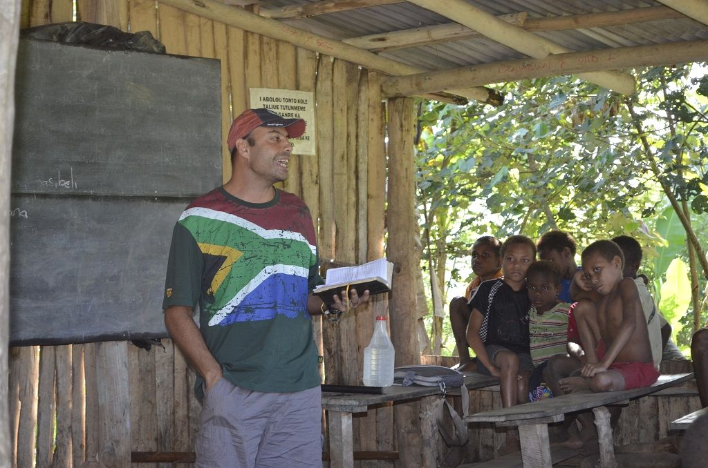 missionary teaching a Bible lesson in Papua New Guinea
