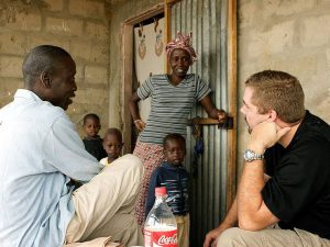 missionary chatting with neighbours in Africa