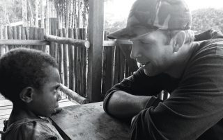 missionary talking to a young boy