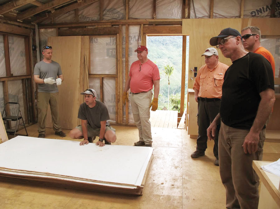 workteam helping Jeremy build their house in the village