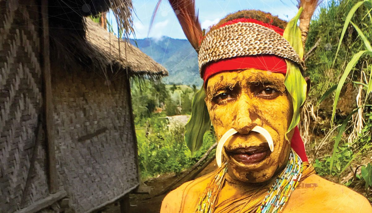 man in traditional garb and paint