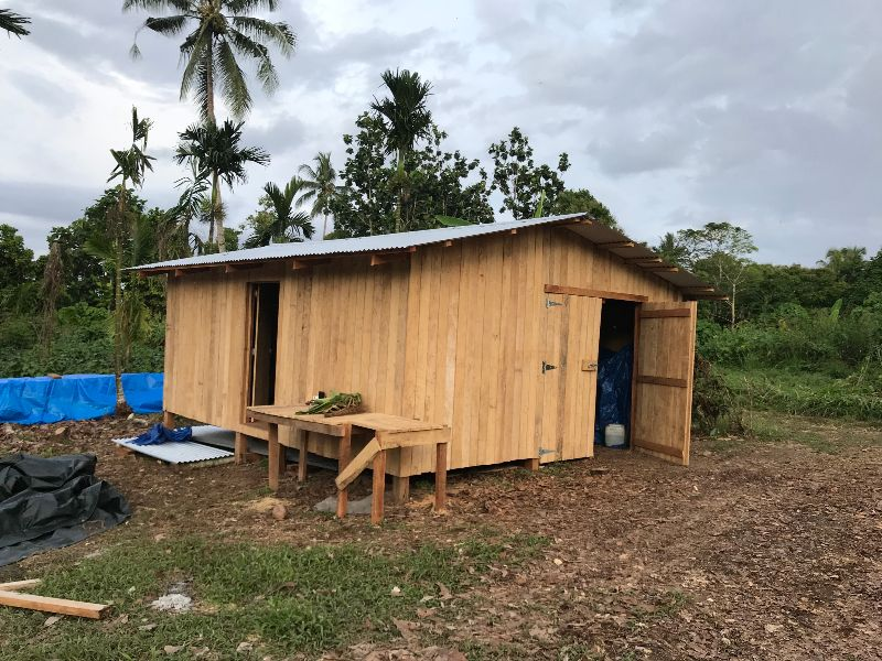 simple wooden shed to be used as a temporary house for a missionary