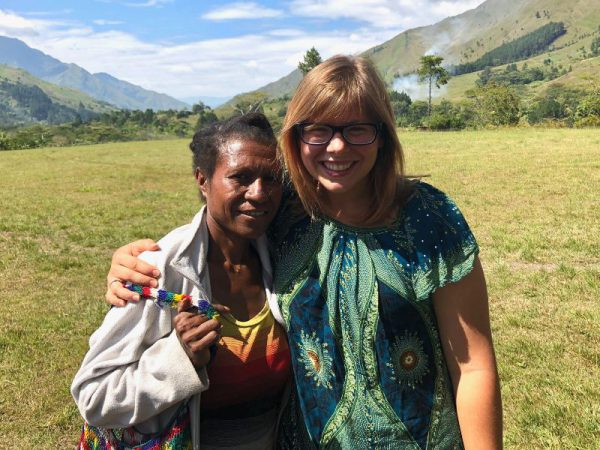 missionary woman standing on the airstrip with a Menyan woman