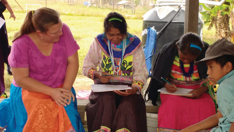 missionary helping people learn to read