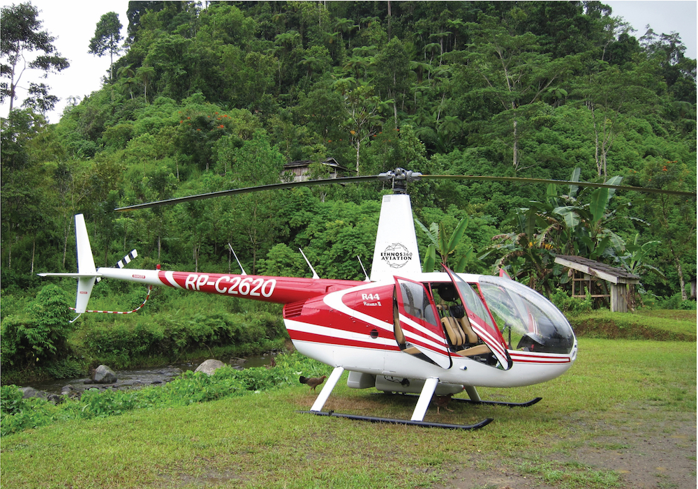 r66 helicopter in a clearing in the jungle