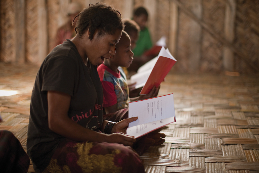 tribal literacy class practicing their reading