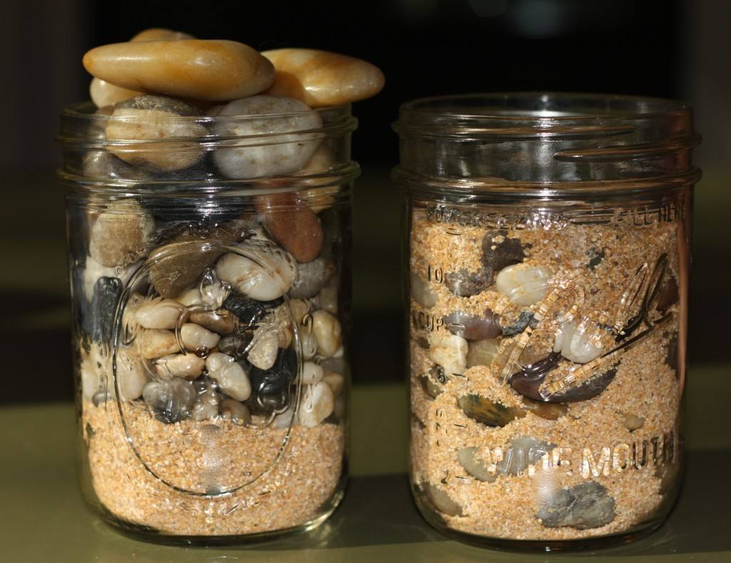 jars full of rocks and sand