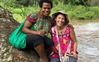 missionary woman with her Papua New Guinean friend by a river