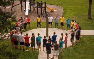 students gathered in a circle at Wayumi retreat