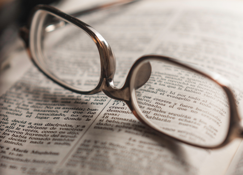 reading glasses on open Bible