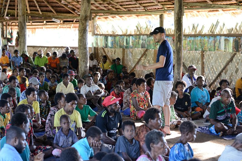 missionary teaching a group of people