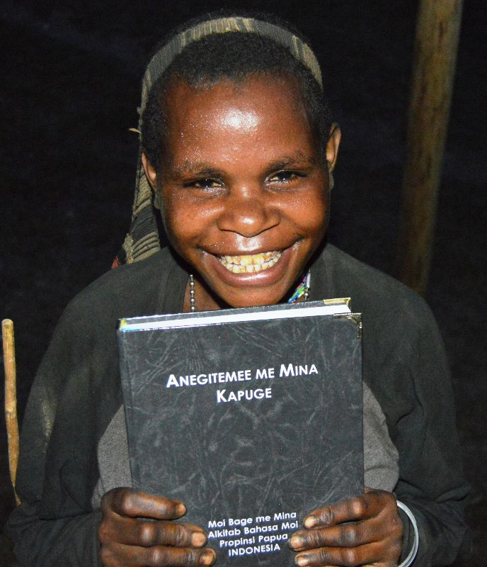 Moi woman with her first Bible