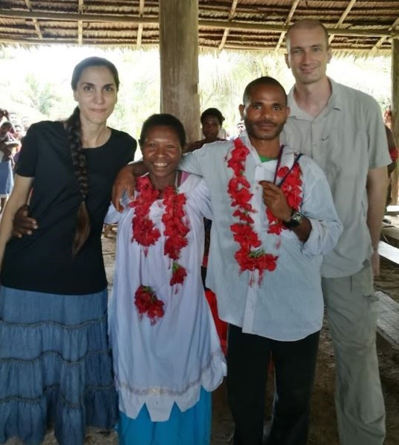 bride and groom with missionary friends