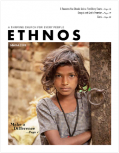 June 2019 Ethnos Magazine cover - tribal girl standing by a tree trunk
