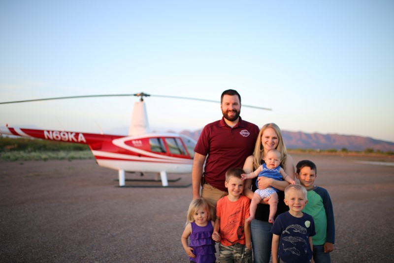 the Minium family standing in front of a helicopter in Arizona