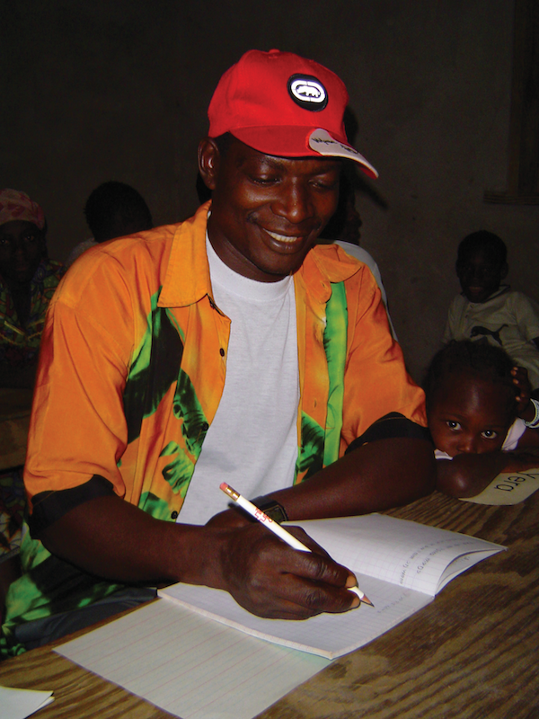 West African man practicing his writing