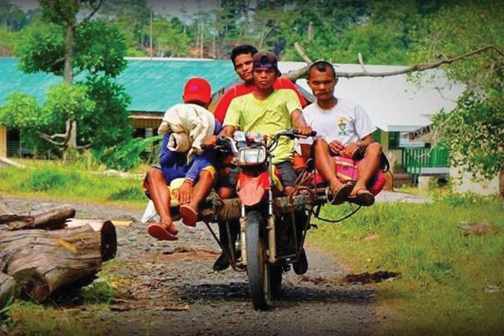 Filipino motorcycle taxi with 3 passangers