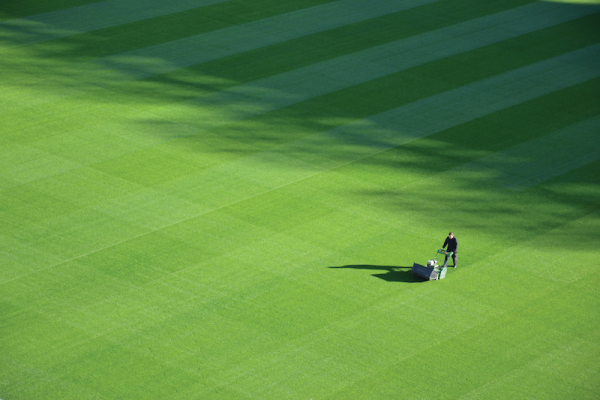 aerial view of a man mowing a large lawn