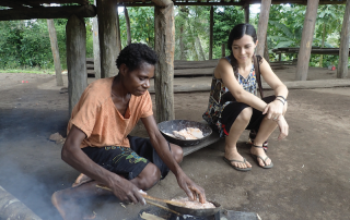 missionary watches as a friend cooks under her house